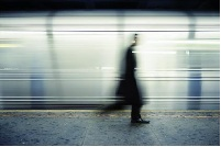 Blurry figure in front of train